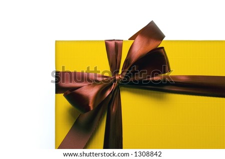 Yellow present with a red ribbon on a white background - stock photo