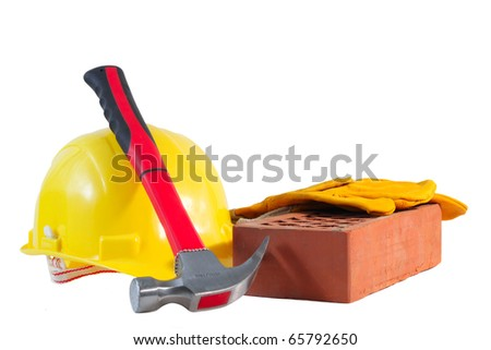 Yellow protective helmet, hammer, protective gloves and brick, isolated on white