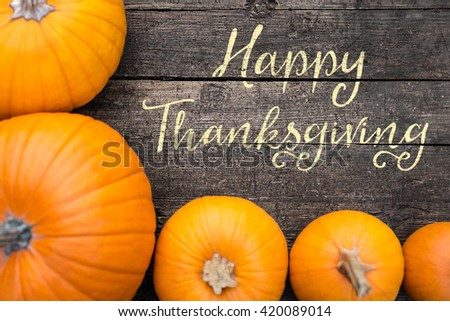 Yellow Pumpkins on a old wooden table, Text Happy Thanksgiving, Flat lay - stock photo