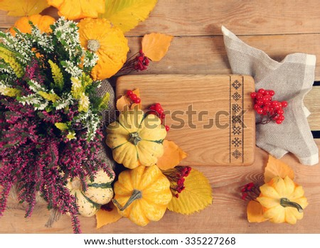 yellow pumpkins on wooden background - stock photo