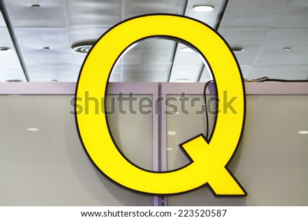 Yellow Q letter sign.