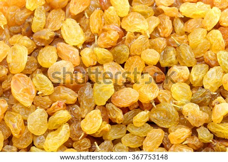 Yellow raisins are a delicious dried grapes are photographed close-up on the entire frame - stock photo
