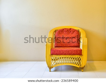 Yellow rattan armchair in room, background - stock photo