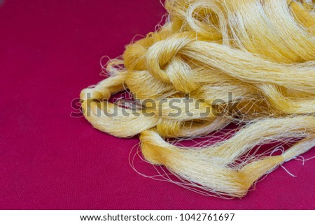 yellow raw silk on red cloth