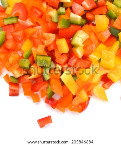 Yellow, red and green peppers Bulgarian. Slicing. Cubes on white  - stock photo
