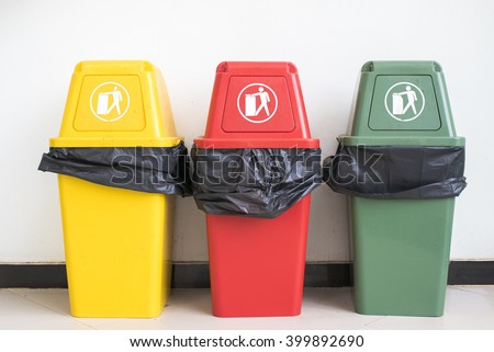 Yellow, Red and Green Recycle Bin on the floor and white wall - stock photo