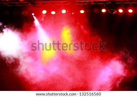 Yellow, red, orange and white smoke in the dark sky - stock photo