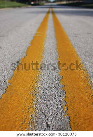 Yellow reflective stripe in center of road - stock photo