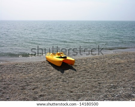 Yellow rescue boat on the lake beach