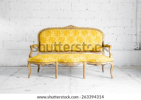 Yellow Retro classical style Armchair sofa couch in vintage room - stock photo