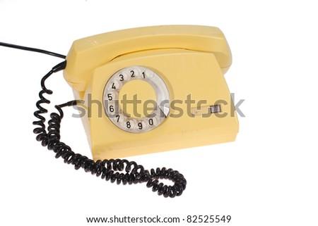 yellow retro phone isolated on a white - stock photo
