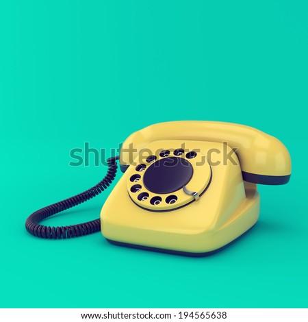 Yellow retro telephone on blue background. Vintage rotary dial phone technology illustration. - stock photo