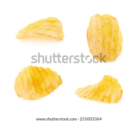 Yellow ribbed potato chips isolated over the white background, set of four different images - stock photo