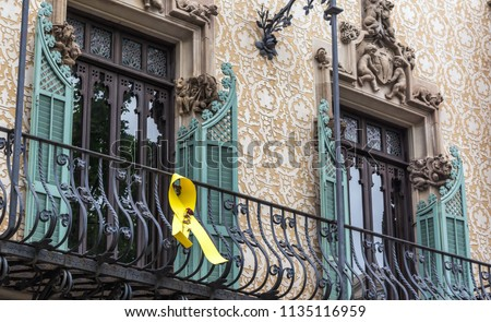 stock-photo-yellow-ribbon-hanging-on-the