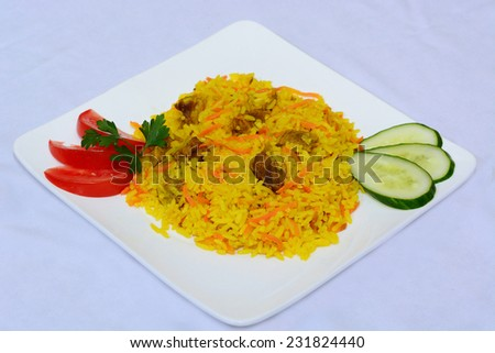 Yellow rice pilaf with carrots and meat - stock photo