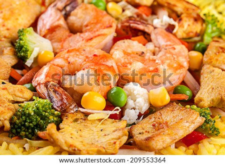 Yellow rice with tiger shrimp and vegetable