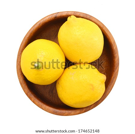 Yellow ripe lemons isolated in wooden bowl on white background  - stock photo