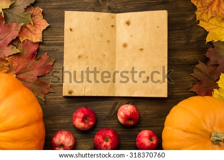 Yellow ripe pumpkin, maple leaves, red apples, wheat on wooden background. Thanksgiving, autumn, homemade, recipe, mock up. - stock photo