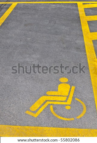 Yellow road marking for disabled parking space