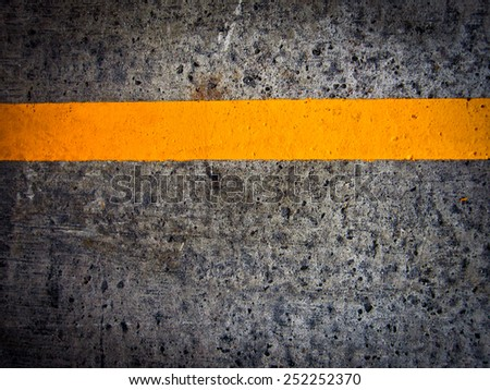 Yellow road paint - stock photo