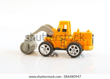 yellow road roller toy isolated on white background,selective focus
