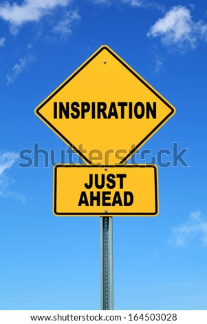 Yellow road sign inspiration just ahead - stock photo