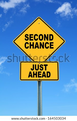 Yellow road sign second chance just ahead - stock photo