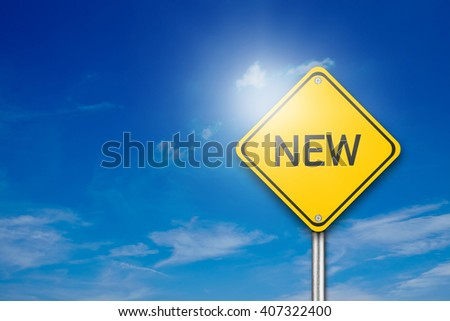 Yellow road sign with word New on blue background - stock photo