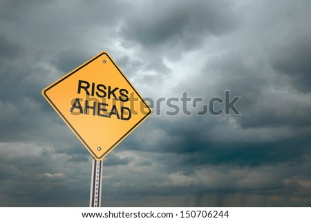 Yellow road warning sign , Risks Ahead  - stock photo