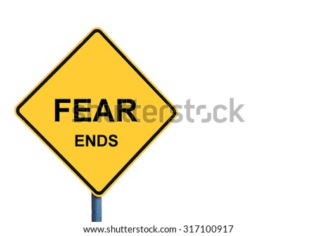 Yellow roadsign with FEAR ENDS message isolated on white background