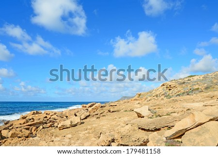 yellow rocks by Argentiera shore, Sardinia