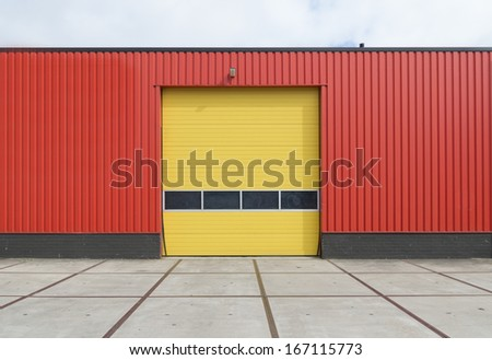 yellow roller door in an orange building