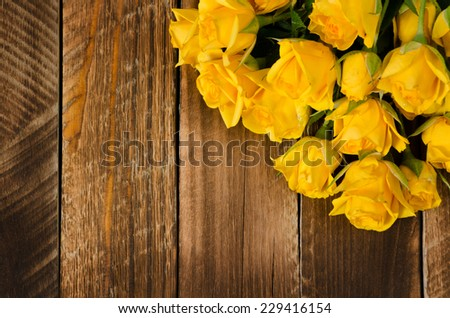 yellow roses on a wood old panels  - stock photo
