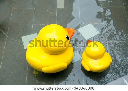 Yellow rubber duck on water