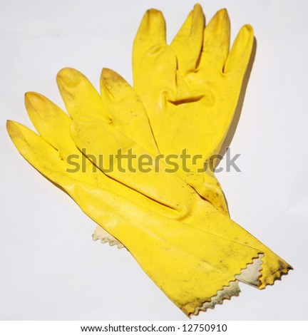 yellow rubber gloves on white represnting the cleaning industry
