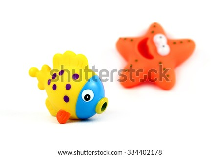 Yellow rubber toy fish for bathing isolated on white