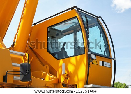 Yellow safety cabin for construction crane operator - stock photo