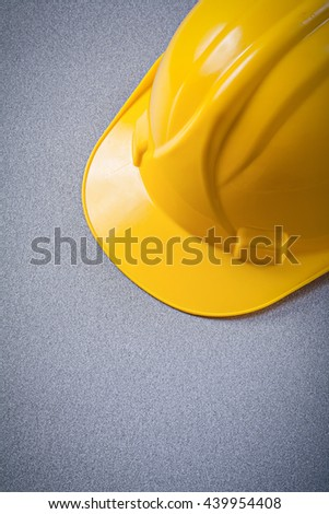 Yellow safety hard hat on grey background construction concept. - stock photo