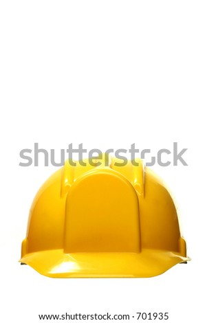 yellow safety headgear on white background with copy space - stock photo