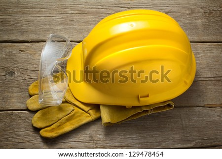 Yellow safety helmet - stock photo
