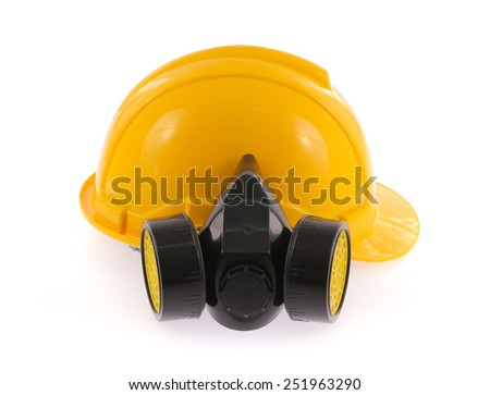 Yellow safety helmet and chemical protective mask isolated on white background