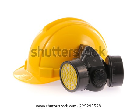 Yellow safety helmet and chemical protective mask isolated on white background - stock photo