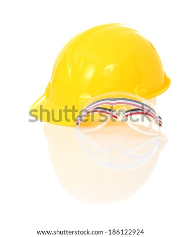 Yellow safety helmet and goggles with reflect on white background
