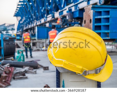 Yellow safety helmet with worker on express way construction site in Bangkok, Thailand