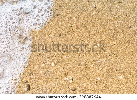 Yellow sand beach and sea waves