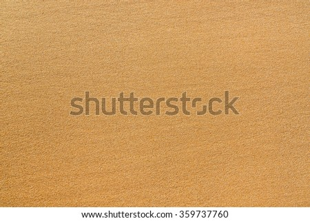 Yellow sand texture as background - stock photo