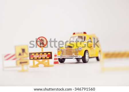 Yellow school bus ( toy model ) with traffic signs the road crossing.Selective focus and Shallow depth of field composition. - stock photo