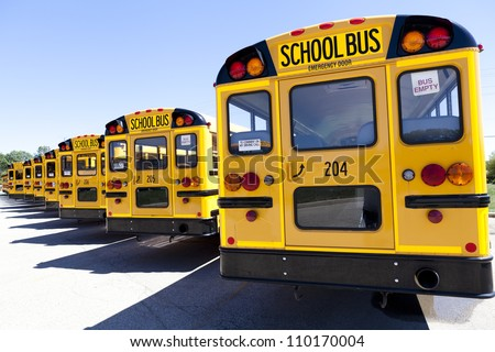 Yellow School Bus With Blue Sky - stock photo