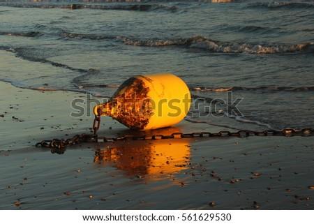 stock-photo-yellow-sea-buoy-dry-due-ebb-