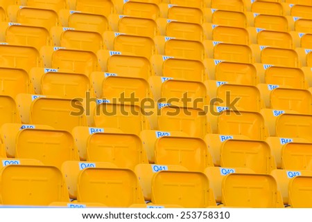 Yellow seat in the stadium. - stock photo